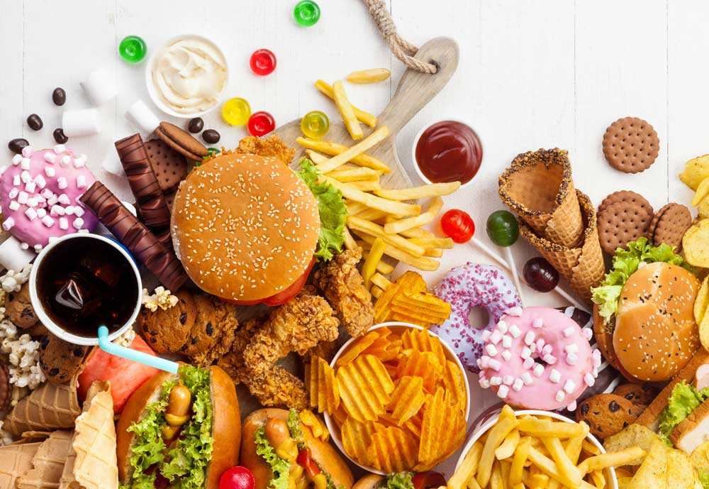 assorted fast food and junk food on table